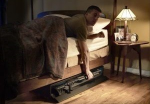 Someone utilizing one of the top bedroom weapon safes we offer